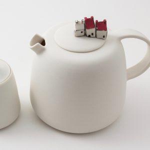 Porcelain teapot with miniature houses