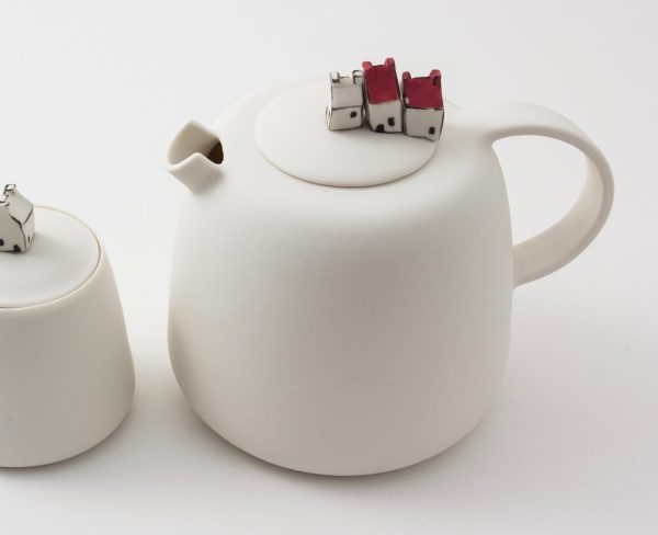 Porcelain teapot with miniature houses